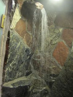 rock waterfall shower, who needs a shower head!