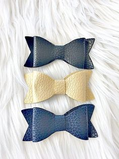 """Our 3"""" Leather and Glitter bows are carefully mounted on no-slip clips. Choose from a wide variety of colors as well."""
