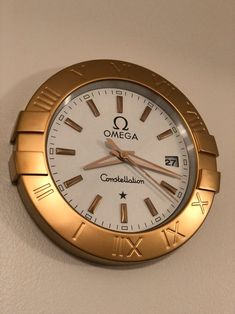 Omega wall clock approx beautiful for home or office, gold color, sweeping hand date works! Gold Wall Clock, Wall Clock Silent, Rolex Oyster Perpetual Date, Clock Display, Rustic Room, George Nelson, Gold Walls, Constellations, Vintage Art