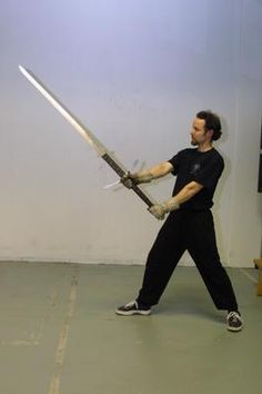 The Greatsword - The Greatswords were large two-handed swords. The length of the Greatsword ranged from from 50 to 72 inches, with a handle that measured 18 - 21 inches in additional length. Greatswords weighed between 6 - 10 pounds. The Greatsword featured an extended handle that allowed the blade to be used in two hands.