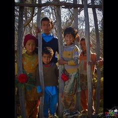 A group of Himachali children pose for tourists, ready to greet them with flowers from their garden, in Naldehra, Himachal Pradesh. #India #himachalPradesh #wanderlust #travelphotography #TheMemoryWeaver