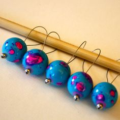 These stitch markers are just like jewelry for your knitting! Made with beautiful ceramic beads in teal and hot pink, they are perfect for showing