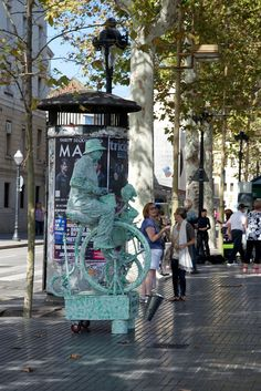 La Rambla is about a mile long and lined with historical buildings, restaurants, cafes, and a number of artists and living statues. Follow this link to see more: http://mikestravelguide.com/things-to-do-in-barcelona-stroll-down-la-rambla/