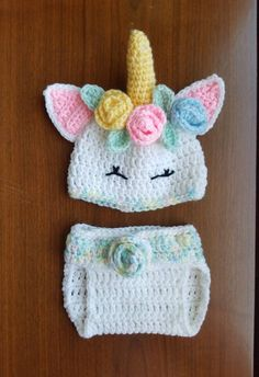 dbd6a5ba2a3 Crocheted unicorn hat and diaper cover set size 0-3 months. Soft acrylic  yarn in pastel colors. Diaper cover has button closure with 2 hidden  buttons for ...