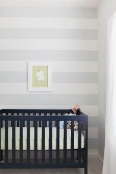 Grey and White Stripes or navy blue and white stripes will be PERFECT for the nursery..a few years away, but this is way you change the decor accent colors to reflect the sex of the baby instead of repainting the room every time you pop one out.