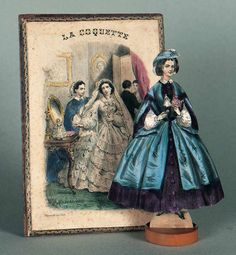 """French boxed set of double-sided paper dolls """"La Coquette,"""" circa 1860, edited by Rousseau, Paris, and lithographed by Jannin, Paris."""