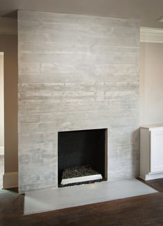 Modern Brick Fireplace porcelain tile clad solid surface slab on