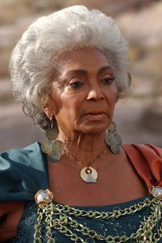 Nichelle Nichols reprises her role of Nyota Uhura from the Original Series.  www.startrekofgodsandmen.net