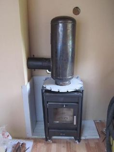 A rocket stove mass heater or rocket mass heater, is a space heating system developed from the rocket stove, a type of efficient wood-burning stove, and the masonry heater, and in this case they are using a wood burning stove as the base for it.Make a rocket bell heater inside the wood stove, and leave open the option of adding mass outside in the future. In more detail: 1. Make A Bell: Cut out the internal square baffle, insert a 19' or less long, 8' diameter stovepipe inside into th...