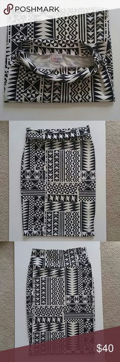 "LulaRoe Cassie aztec tribal geometric pencil skirt Lularoe size XS skirt 96% Spun Polyester 4% Spandex Machine Washable | Simply Comfortable | RN # 142161 Geometric Tribal Aztec print ""Cassie""  About knee length Pic #2 top is folded over, front of skirt Pic #3 is unfolded and picture of the back Excellent Condition. From a Non Smoking home LuLaRoe Skirts Pencil"