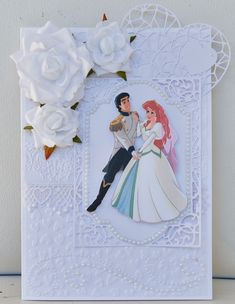 Disney Wedding Card: I have used a Sizzix and a Crafter's Companion embossing folder on this card.  The frame is a Spellbinders die.  The heart is a Poppy Crafts die.  I've also added Bella! Bling pearls and Petaloo flowers.