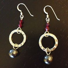 I used sterling silver, Swarovski crystals and hematite beads for these.