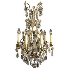 Eight-Arm Brass French Chandelier | From a unique collection of antique and modern chandeliers and pendants at…