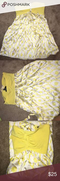 Super cute yellow and white floral silk Bebe top Super cute yellow and white floral silk Bebe halter top. bebe Tops