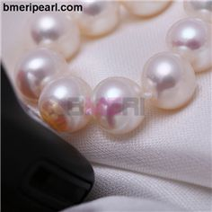 chunky multi strand faux pearl necklace.  Whether you wear an open back dress, V-neck dress, square top dress or strapless dress, drop earrings are simply a great match for any of these dresses. Just bear in mind to wear matching footwear.	visit: www.bmeripearl.com
