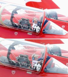 The Duke of Cambridge with Prince George in the cockpit of a Red Arrow during a visit to the Royal International Air Tattoo at RAF Fairford on July 8, 2016 in Fairford, England.