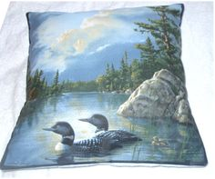 Loons with chick on a lonesome lake cushion