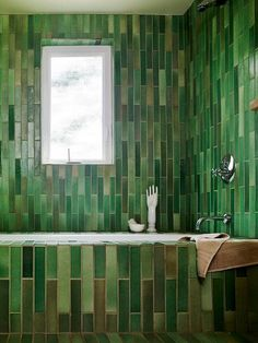 By setting these thin tiles vertically in this bathroom they gave it a kind of bamboo effect. Very neat, I wonder how it would look in other colors.
