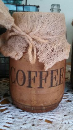 Primitive vintage jar paper bag labeled with tea Stained cheesecloth scented with vanilla and cinnamon