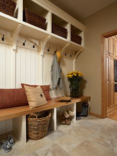"""I really like this bench for an entry! Shoes can go in the baskets under the bench so they have a """"home"""". Something similar may end up in my house!"""