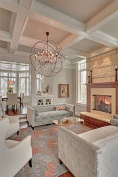 There is something lovely about this living room. The gray furniture is very pretty, especially w/ the coral accents. And that light fixture! How awesome is that?