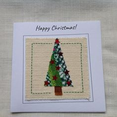A handmade Christmas card for the holiday season created by carefully sewing strips of green fabrics to represent a Christmas tree and then adorned with shining red stars. Each card is individually made so small differences make it uniquely special. This listing is for one card,
