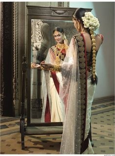 South Indian Wedding Sari with lots of flowers in the hair
