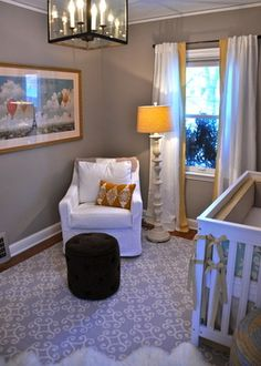 I like the storage ottoman and interesting details in this nursery