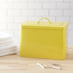 8 Laundry Room Essentials for the New Year: West Elm Yellow Bin/Remodelista