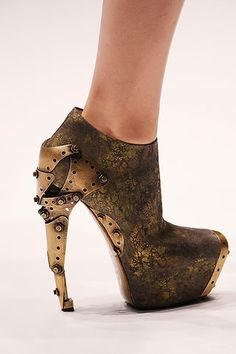 Alexander McQueen spring 2010....maybe I wouldn't wear a lot (since I don't wear high heels a lot).....but soooo cool....reminds me of the movie Hugo