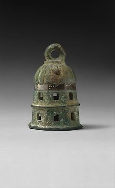 """Bell. ca 789-766 BC. Armenia This classical Urartian bell has a domed top, an octagonal and perforated body with a central raised ridge, and a loop for suspension. The Urartian cuneiform inscription reads: """"From the arsenal of [King] Argishti"""