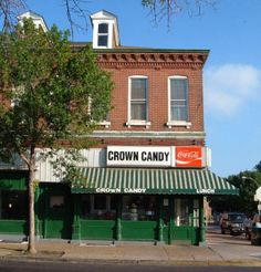 September 2006: Through prosperity and decline, this scene has hardly changed for decades. Crown Candy Kitchen, at St. Louis Avenue and 14th, is a traditional soda and malt shop; it is the area's most famous locale and a draw for people from all over the region.