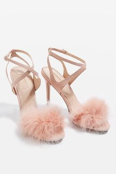Update strappy sandals with these luxe pair of heeled sandals in nude with feather feature to the toe strap.
