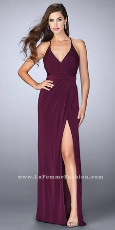 Look your very best at your next special event in this Cascading Rhinestone Embellished Jersey Pleated Prom Dress by La Femme. This simple but elegant style features a V-shape neckline with a surplice fitted bodice and elegant draped pleating. This jersey column silhouette dress also includes a jaw dropping thigh high slit, a gorgeous open back with a center back zipper, and cascading rhinestone embellishments that will leave you being the talk of the party. #edressme