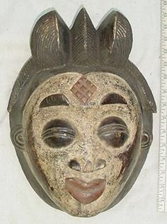 Image from http://www.thesmithsshop.com/T_up__Puno_Wedding_Mask_Cameroon.jpg.