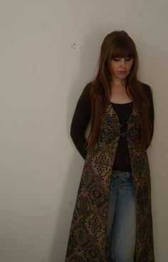 A stunning and original vintage 70s long tapestry waistcoat by Jenny Sharp. Fully lined with pink silk lining, the thick tapestry is in shades of brown, beige and pale blue in an aztec, paisley like pattern. Has duffel buttons on front and sweeps down to ankles. In great vintage Pink Silk, Brown Beige, Vintage 70s, Childhood Memories, Aztec, Paisley, Vintage Outfits, Tapestry, Shades