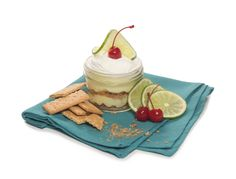 KEY LIME MOUSSE layered with crystallized graham cracker crust and whipped cream #SoEatingThis #houlihans