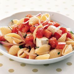 Mozzarella cheese, pasta, and beefsteak tomatoes form the base of this warm salad.