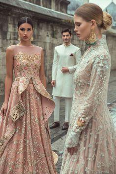 Tissue worked peplum with net lehnga Indian Bridal Lehenga, Indian Gowns, Indian Attire, Pakistani Wedding Outfits, Pakistani Dresses, Indian Designer Outfits, Designer Dresses, Indian Engagement Outfit, Tarun Tahiliani