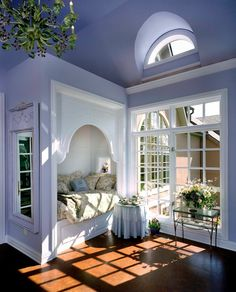 Traditional Guest Bedroom with Natural light, Arched window, Built-in daybed, Concrete floors, High ceiling