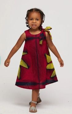 Your little one would love to match with you in this beautiful African print. Every little girl will feel beautiful in this gorgeous piece. Baby African Clothes, African Dresses For Kids, African Children, Latest African Fashion Dresses, African Print Dresses, Little Girl Dresses, Ankara Styles For Kids, Girls Dresses, African Dress Patterns