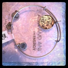 Alex and Ani silver frozen Ana and Elsa Bracelet Alex and Ani silver frozen Ana and Elsa Bracelet. Brand new with tags. Purchased at Disney world Florida. Make offer with offer button. All must go. Moving soon. Thank you!! Alex & Ani Jewelry Bracelets