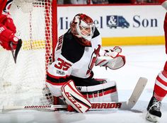 RALEIGH, NC - JANUARY 03: Cory Schneider #35 of the New Jersey Devils hugs the pipe to defend the net during an NHL game against the Carolina Hurricanes on January 3, 2017 at PNC Arena in Raleigh, North Carolina. (Photo by Gregg Forwerck/NHLI via Getty Images)