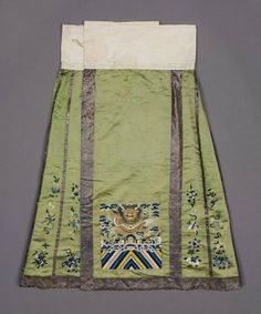 Woman's dragon skirt (mangqun)      Chinese, Qing dynasty, 1880s to 1890s       China Dimensions     88 x 75 cm (34 5/8 x 29 1/2 in.) Medium or Technique     Silk satin embroidered with silk and couched with gold-wrapped thread