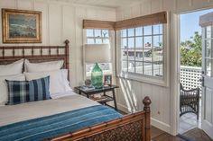 Laguna Beach Cottage Clark Collins Design | hookedonhouses.net/windows, paneling, balcony/blue & white