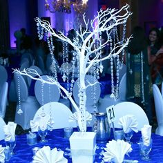 Why not make yours a reality? A crystal-draped white branch centerpiece amidst ice blue and white décor sets the perfect tone for your night as a princess. Want to really feel like Cinderella? Make your entrance in a classic stagecoach, and make your night royally remembered.