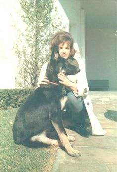 Jackie Kennedy with Clipper, the German Shepard she received from Joe Kennedy. Clipper slept at the foot of her bed.