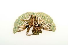 """Ilgiz F """"Hortense"""" brooch with with champlevé enamelling."""