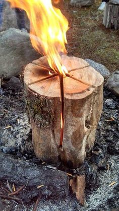 This is called a Swedish Flame. Make your wood cuts like your cutting a cake. Leave about six inches at the base, throw a cap full of fuel oil in there and it will burn up to three hours.