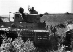 Tigers of the 8.Kompanie, SS-PzRgt.2/2. SS-PzD 'Das Reich', move through the Russian steppes accompanied by SS-Panzergrenadiers, during the early of the Operation Zitadelle, south of the road Tomarowka-Bykowka, Russia. 6 July 1943. by World War 2 Photos, via Flickr